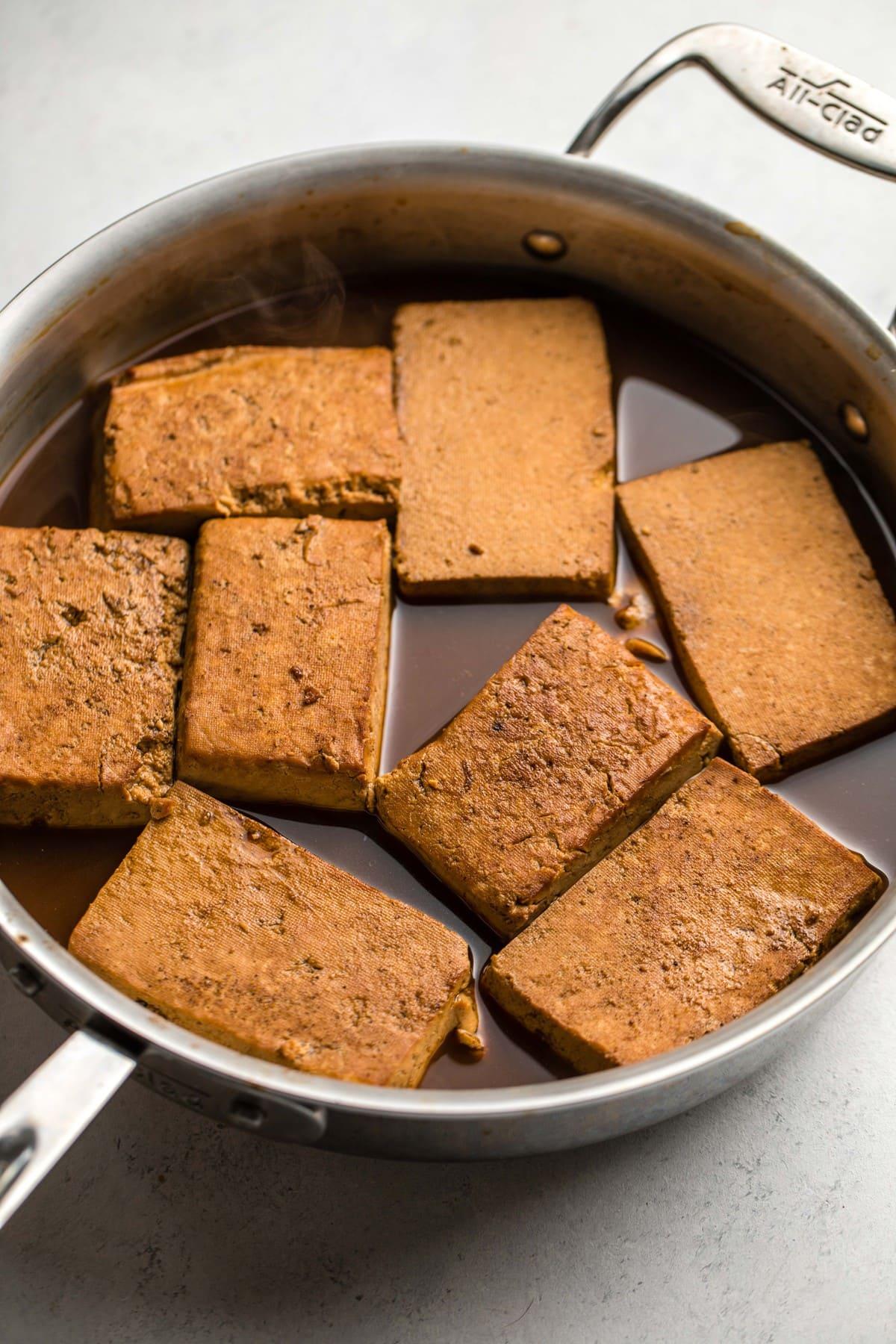 braised tofu in metal pot after baking