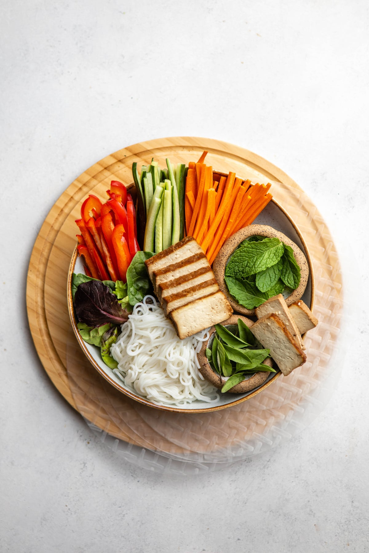 ingredients for rice paper rolls on wood cutting board