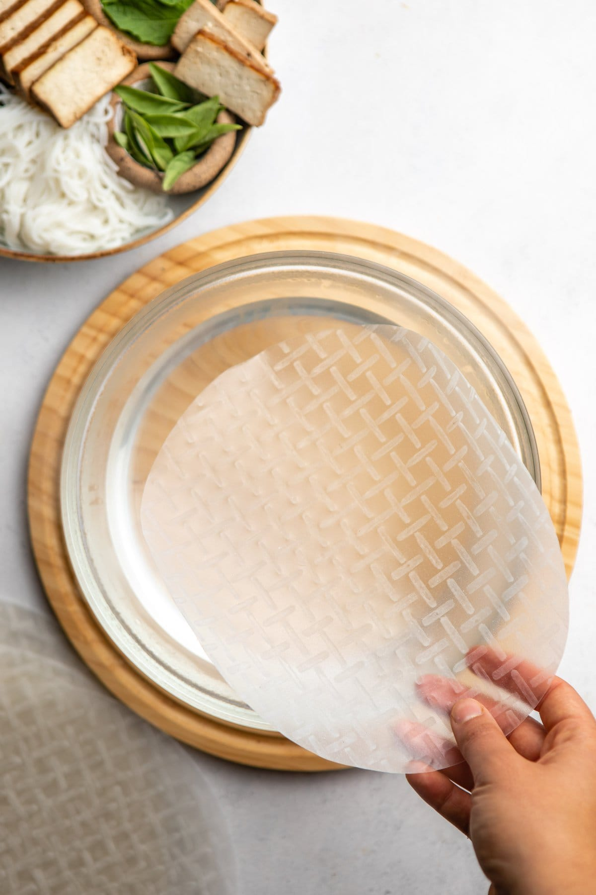 hard rice paper over bowl of warm water