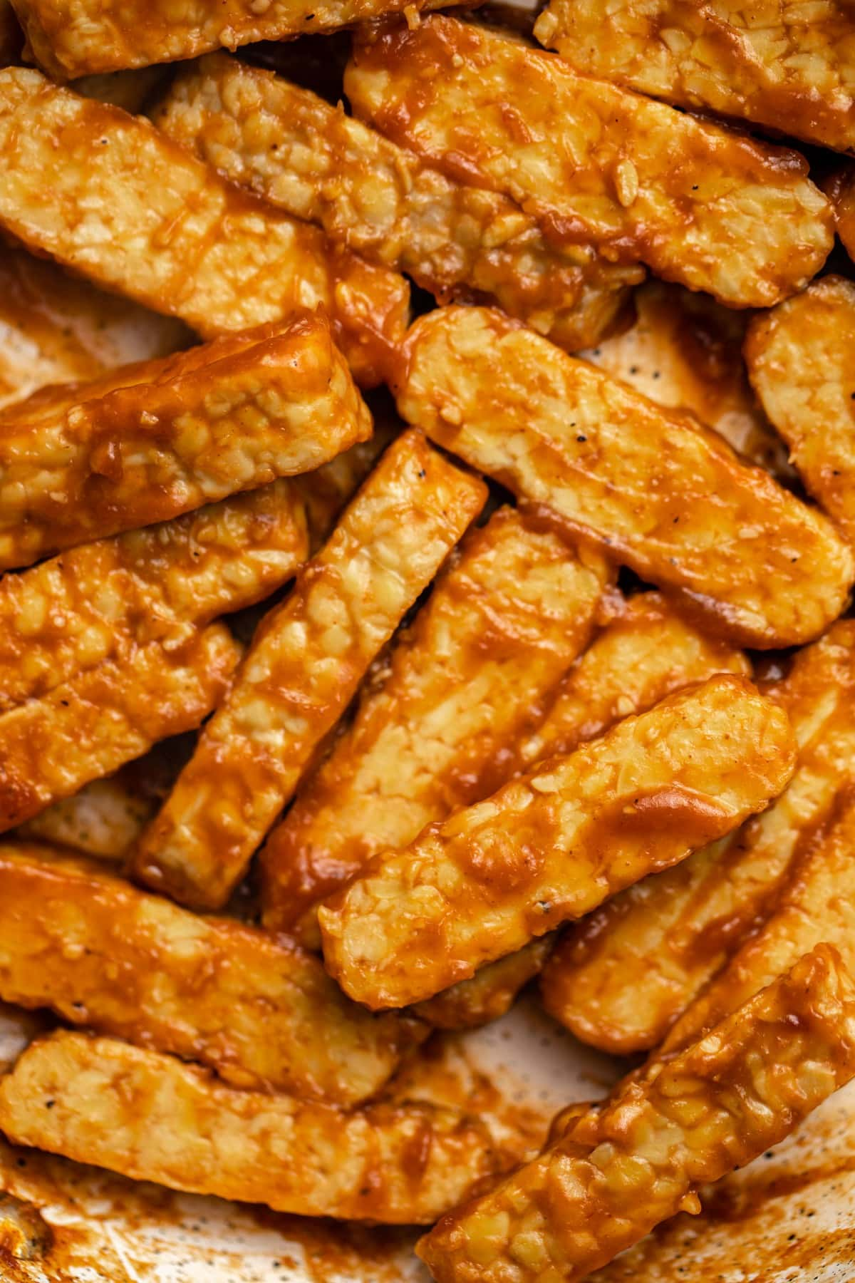close up photo of BBQ tempeh in pan after cooking