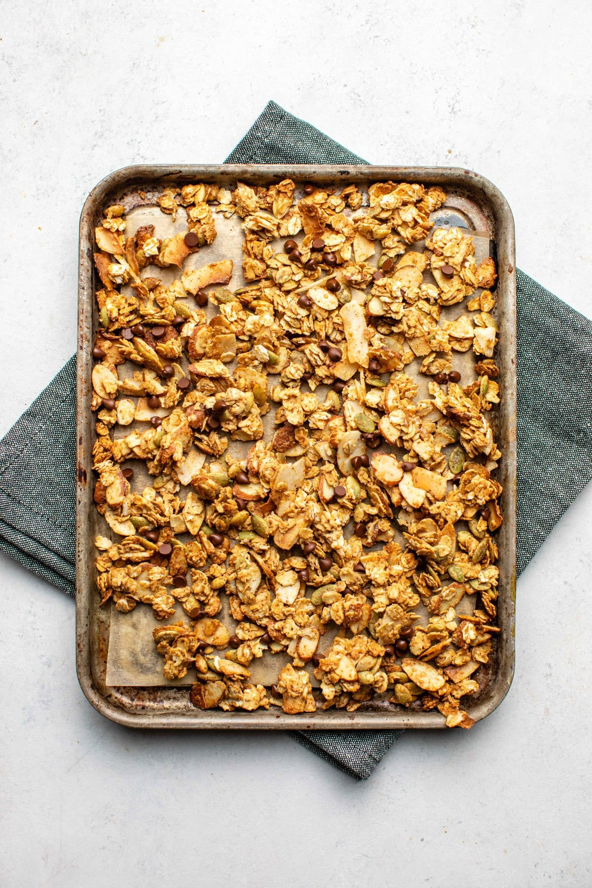 cooked small batch granola on small baking tray over navy napkin