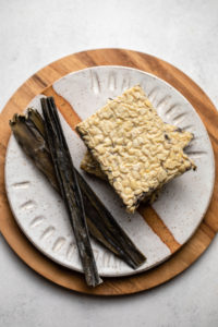 tempeh and kombu on small white plate