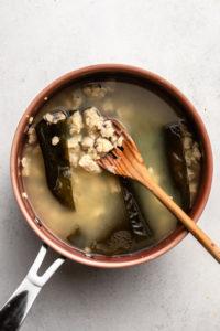 tempeh and kombu simmering in pot of water