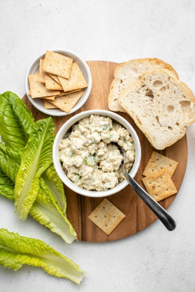 serving suggestions for tempeh tuna salad on round wood cutting board
