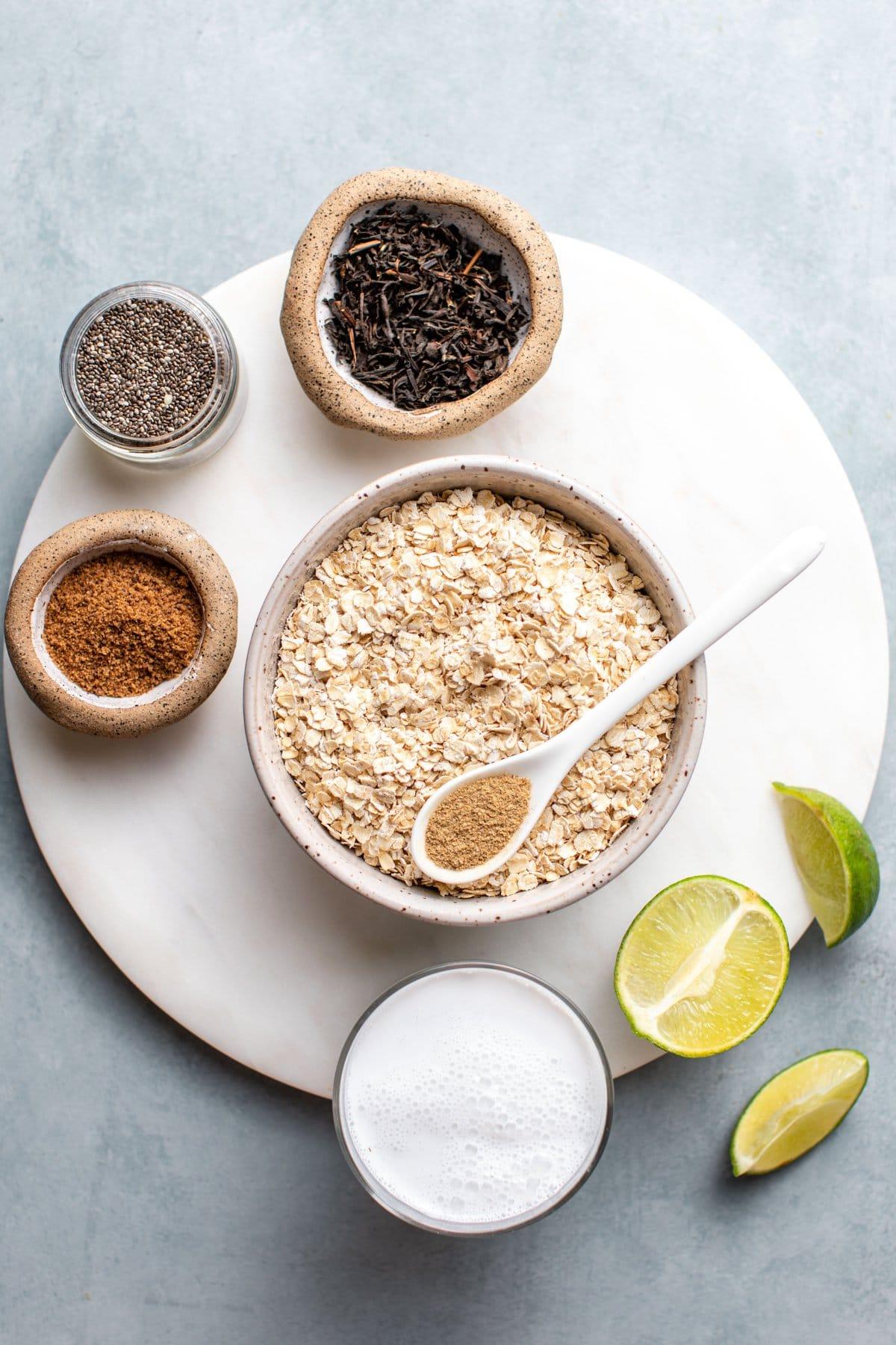 ingredients for thai tea arranged on round white serving board