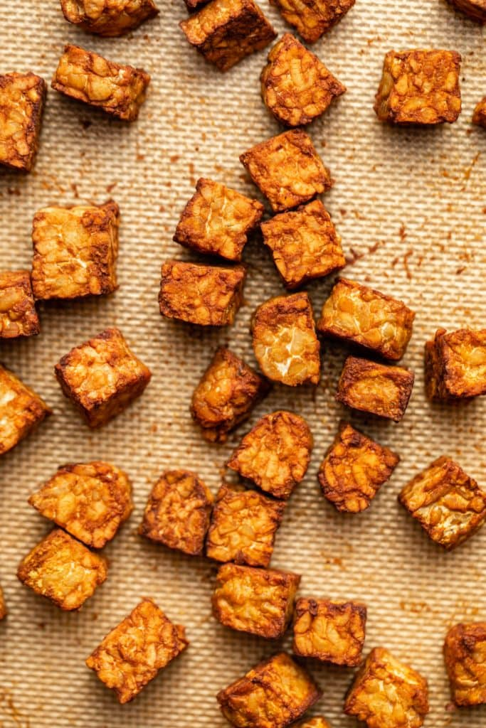 cooked crispy tempeh on baking sheet