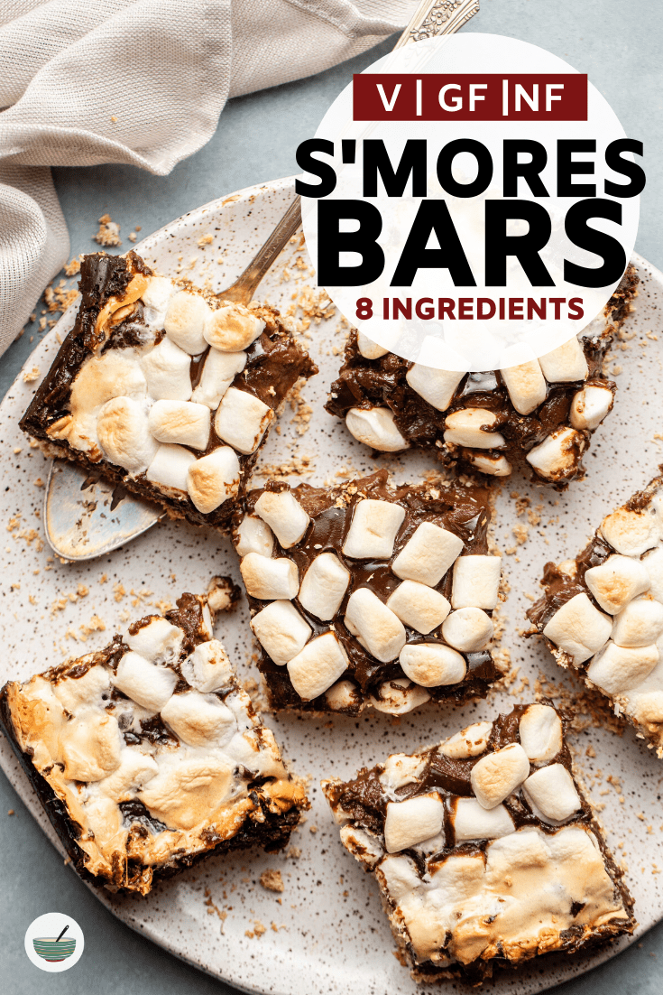 These gooey S'mores bars have a sweet crust, rich chocolate filling, and fluffy vegan marshmallow topping to replicate your favorite campfire treat. #vegan #smores #smoresbars #dairyfree #oilfree #glutenfree | frommybowl.com