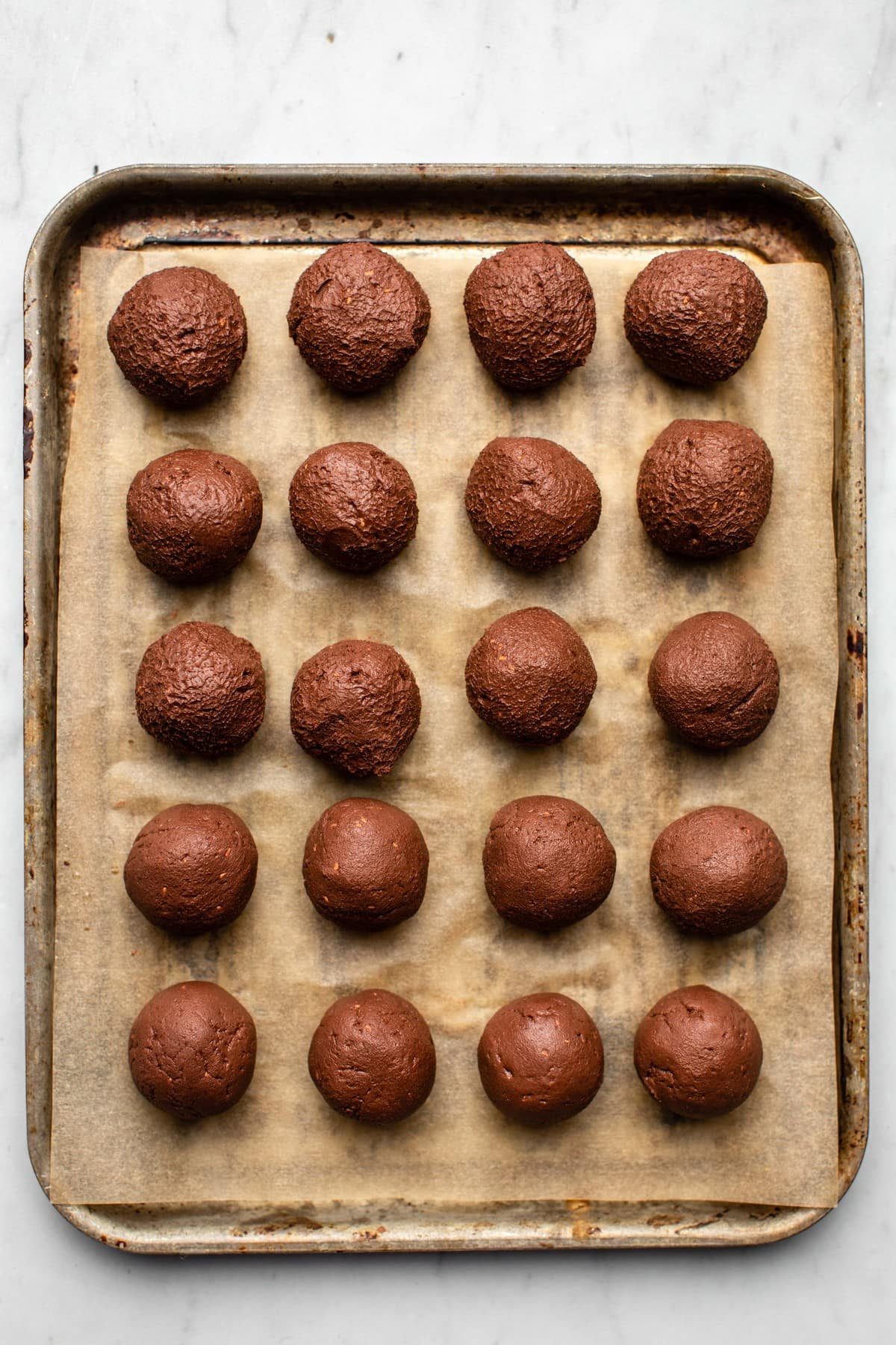 truffles arranged on baking sheet lined with parchment paper