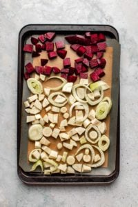 sheet pan of chopped vegetables before they are roasted