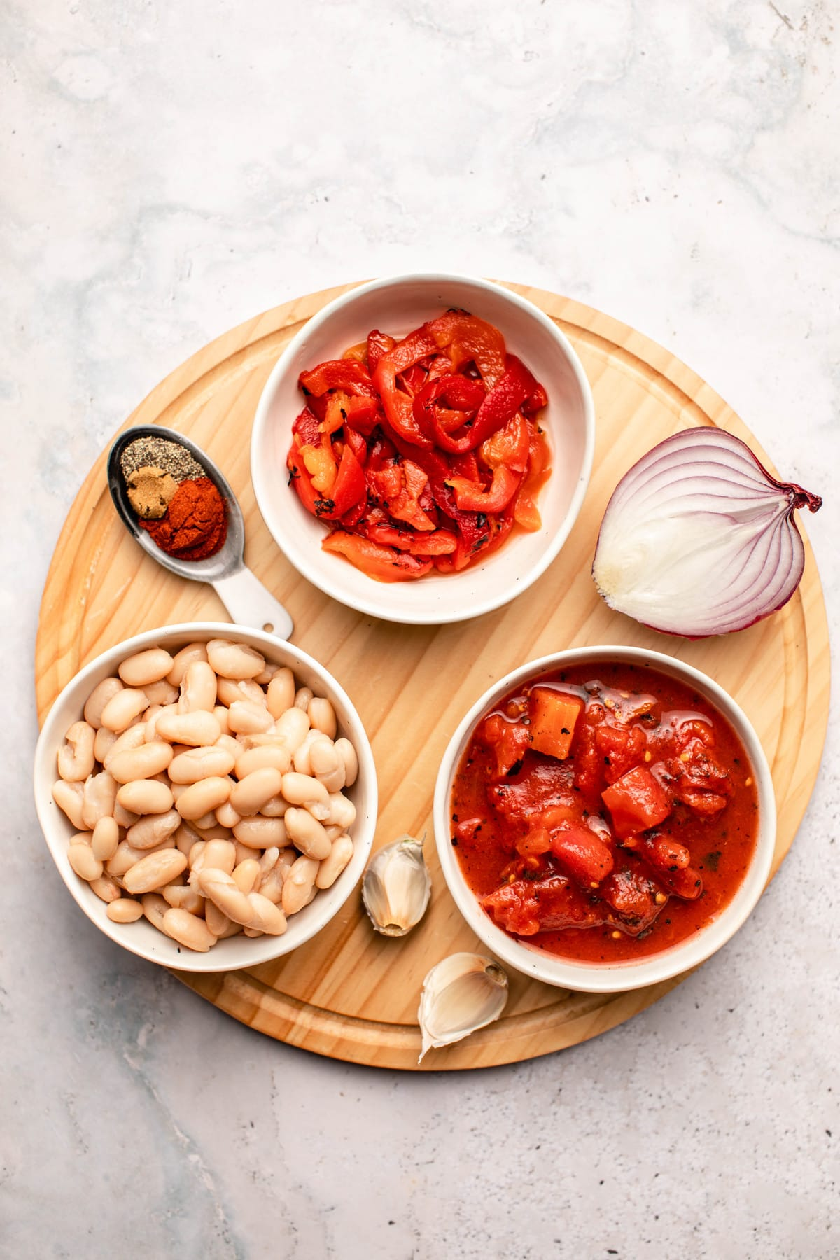 ingredients for sweet and smoky white beans on wood cutting board