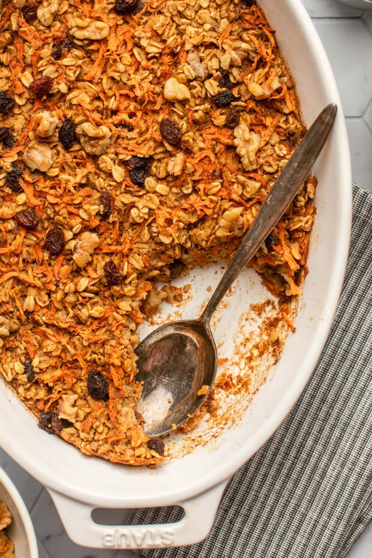 close of photo of baked carrot cake oatmeal on tile background
