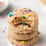 stack of soft baked funfetti cookies with sprinkles on marble background
