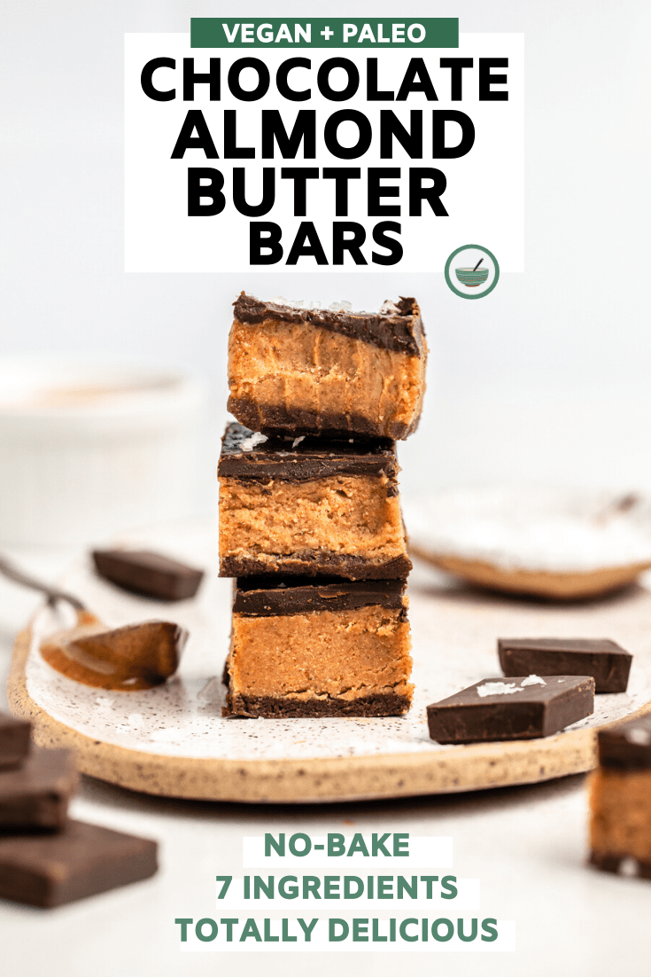 stack of 3 almond butter bars with bite taken out of top bar on white background