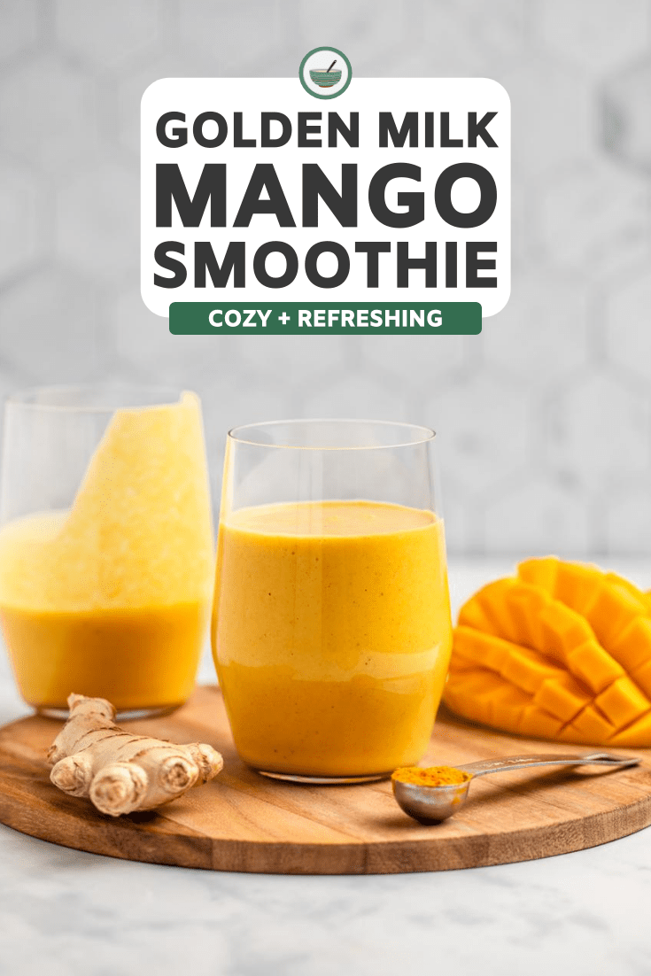 two glasses of golden milk mango smoothie on wood cutting board with sliced mango and fresh ginger on the side