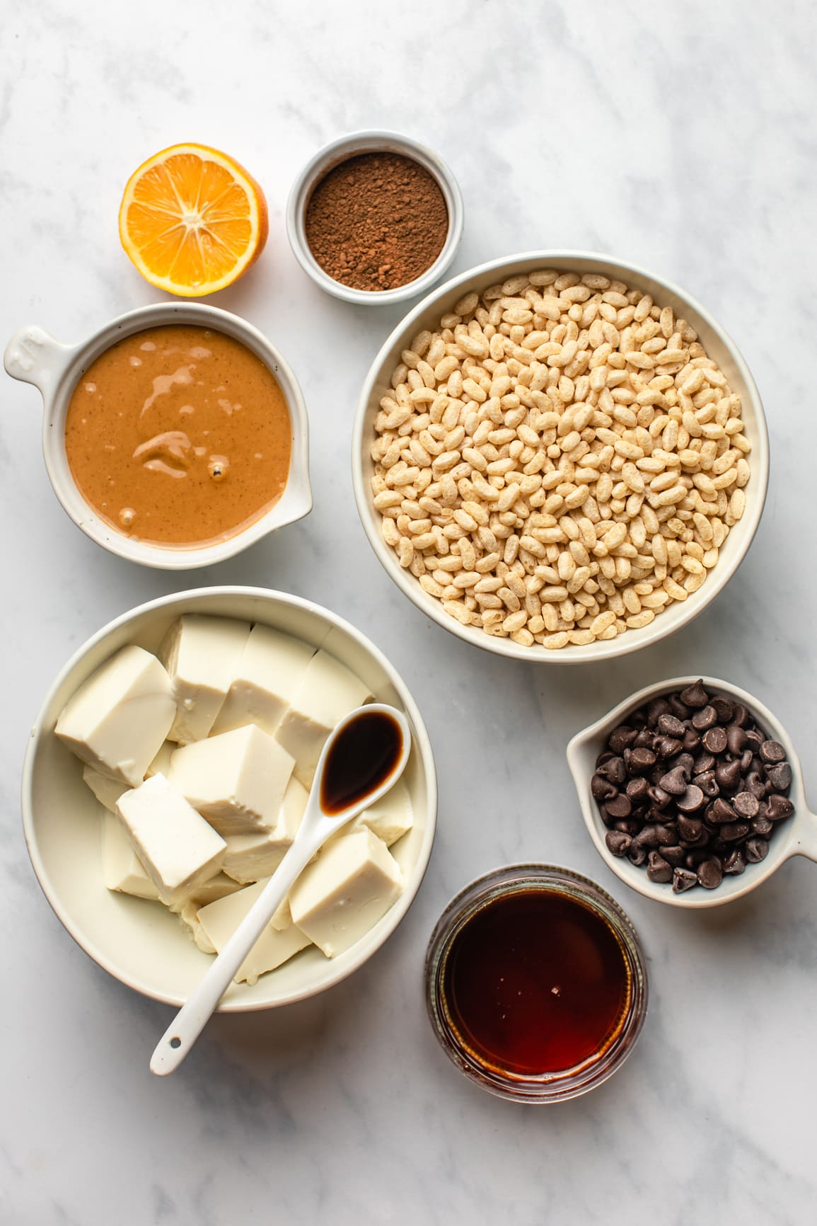 ingredients for no bake peanut butter cup pie in white bowls on marble background
