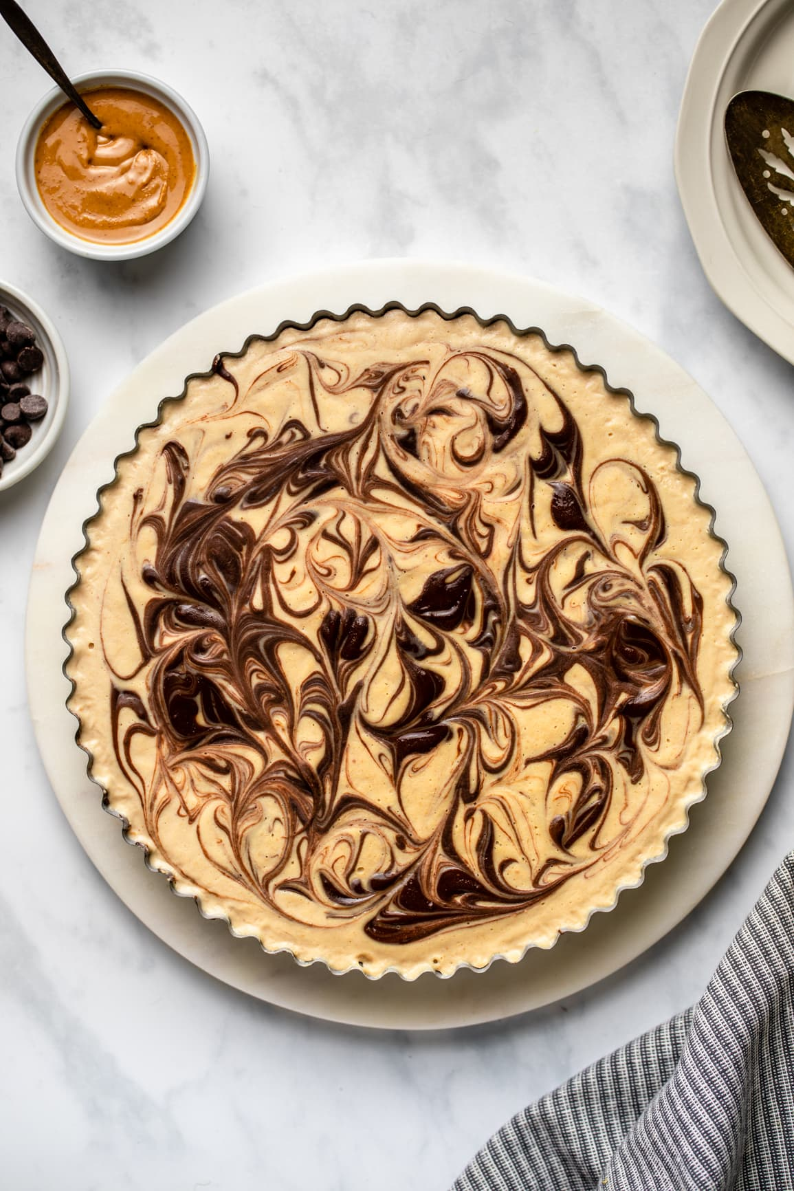 Completed peanut butter cup pie on marble serving tray on marble background