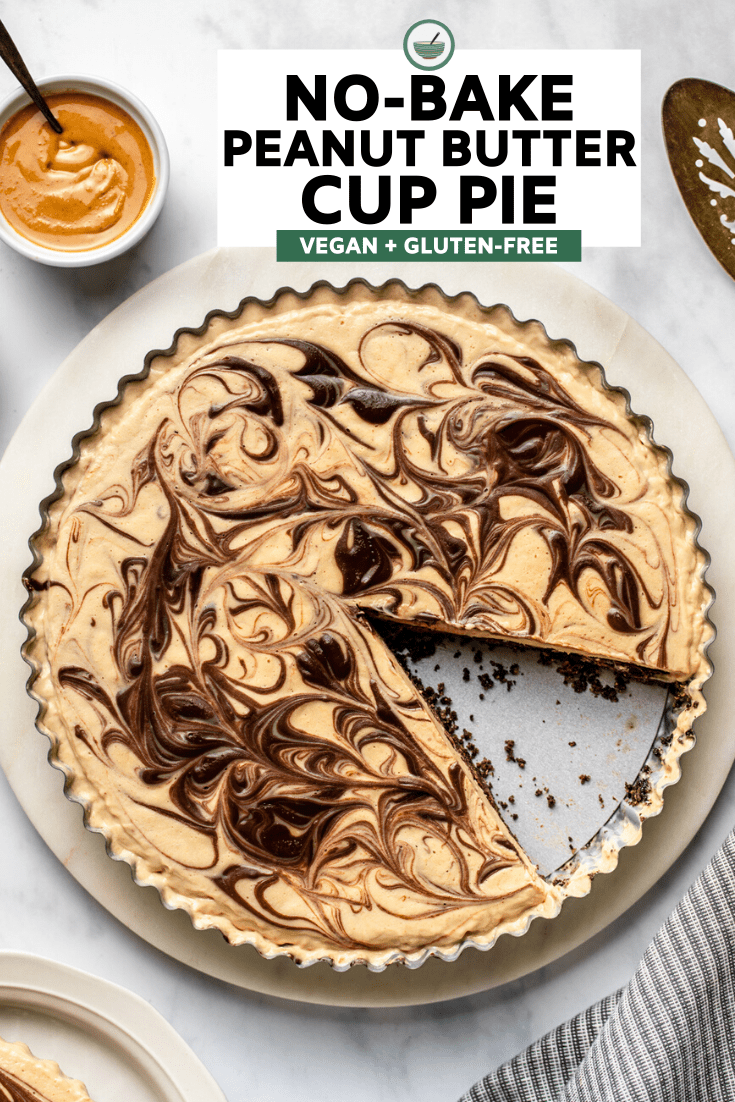 no bake peanut butter cup pie with slice taken out of it on marble background