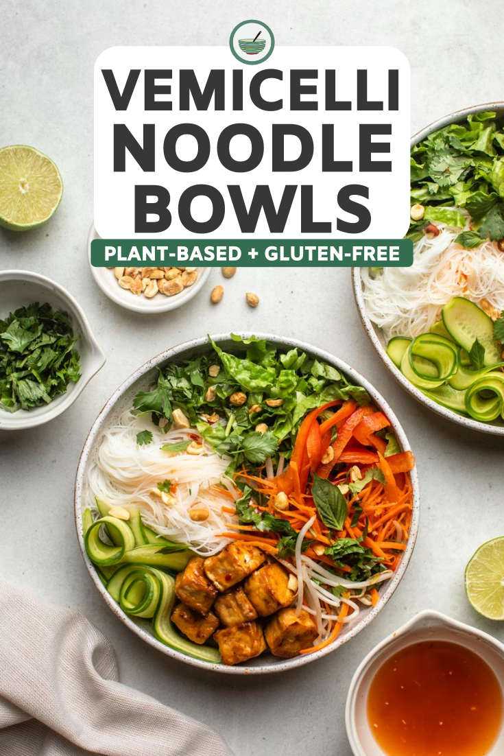 vermicelli noodle bowls on marble countertop with additional ingredients like herbs, lime juice, peanuts, and dressing on the side