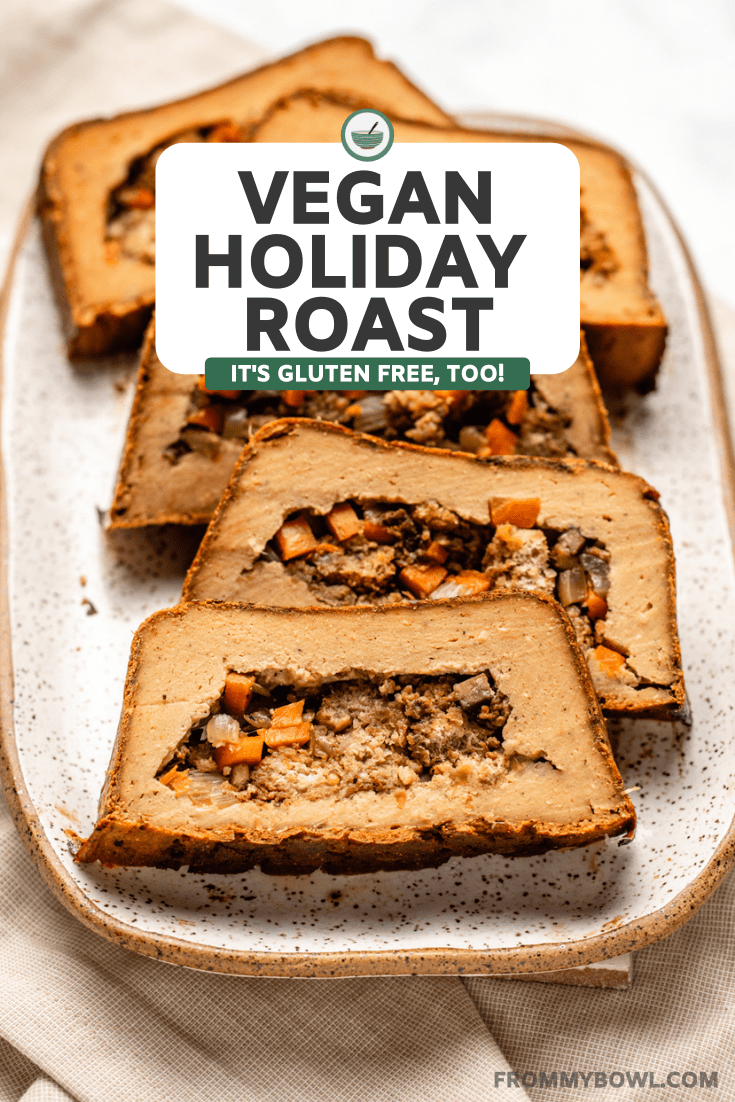 sliced vegan holiday roast on white speckled tray