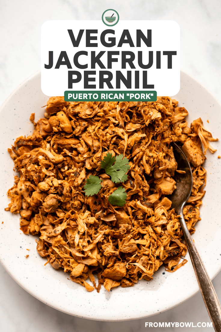 jackfruit pernil in white bowl next to serving dishes of arroz con gandules and tostones