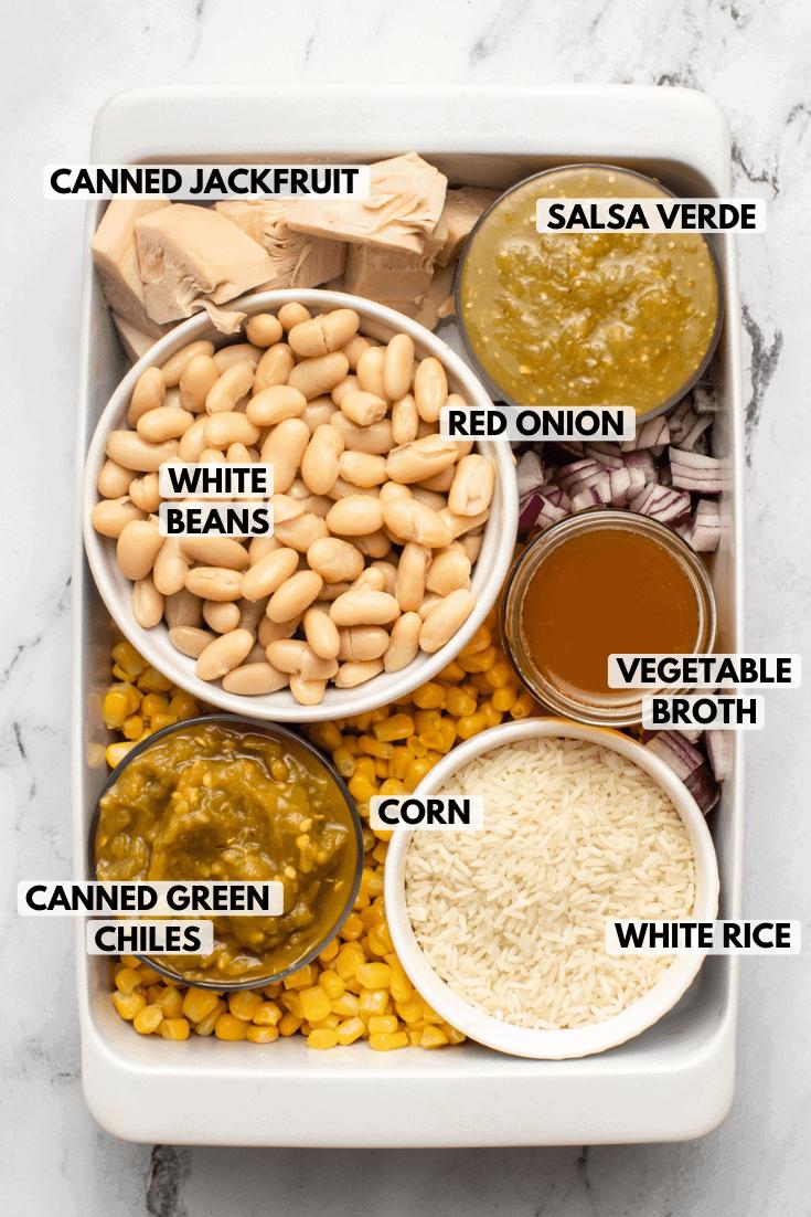 ingredients for salsa verde and white bean casserole in white ramekins