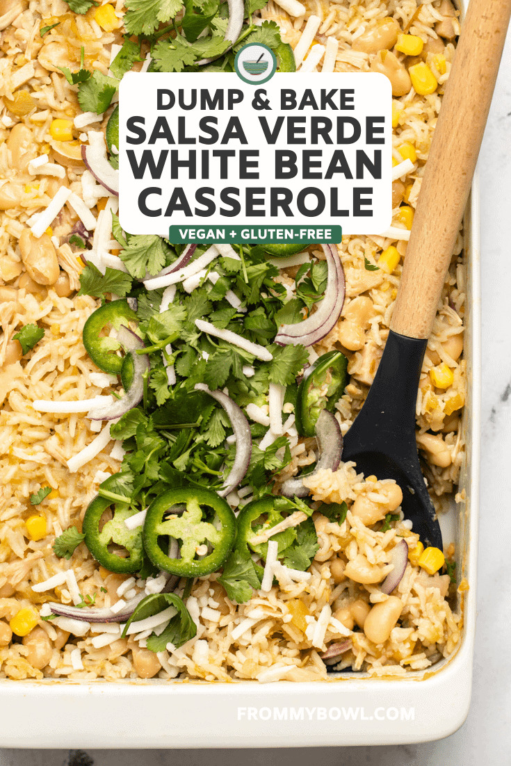 salsa verde white bean casserole topped with cilantro jalapeno and red onion