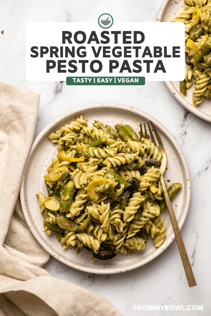 roasted vegetable pesto pasta on two plates on marble background