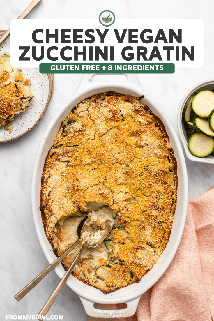 Baked zucchini gratin in white casserole dish with crispy cornmeal topping