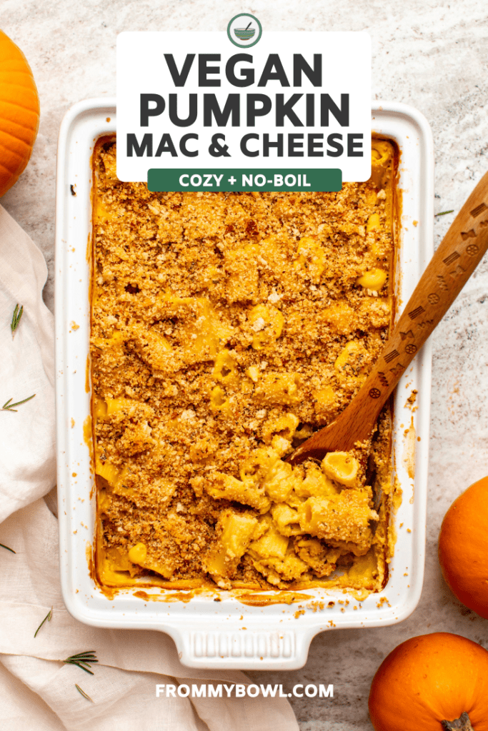 No-Boil Vegan Pumpkin Mac & Cheese in white casserole dish, on marble counter surrounded by pumpkins and rosemary