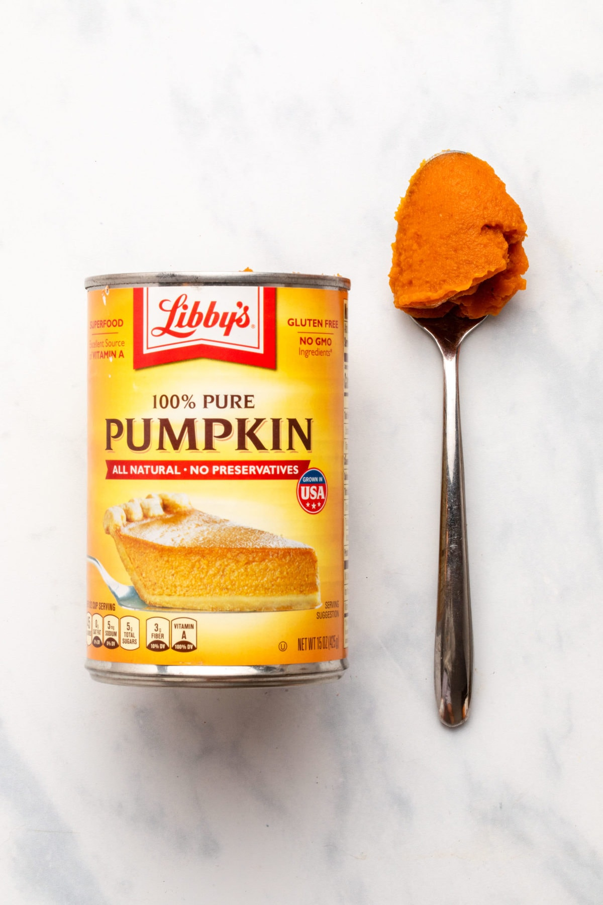 Can of Libby's pumpkin puree next to spoon with puree on it